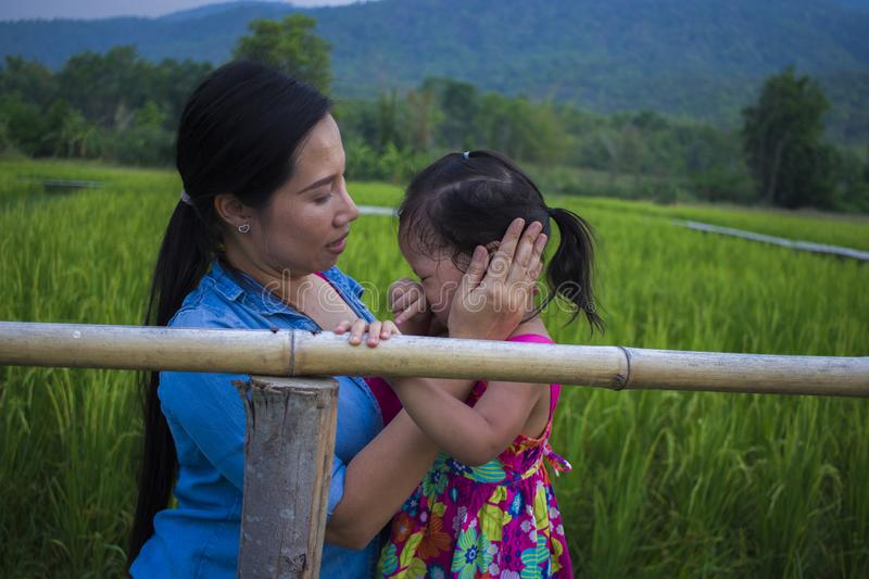 Young mother hugging and soothing a crying little daughter, Asian mother trying to comfort and calm down her crying child stock images
