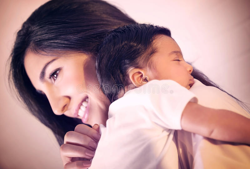 Young mother with little baby stock photography