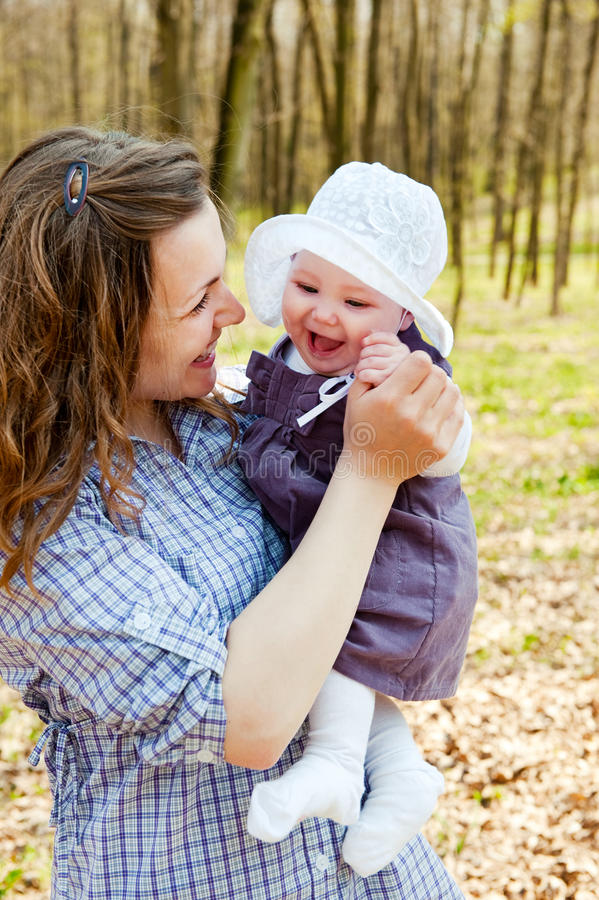 Young mother with little baby daughter in park stock image