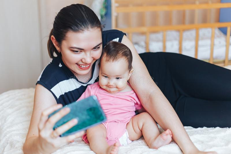 young mother is making selfie with her adorable little baby girl stock photo
