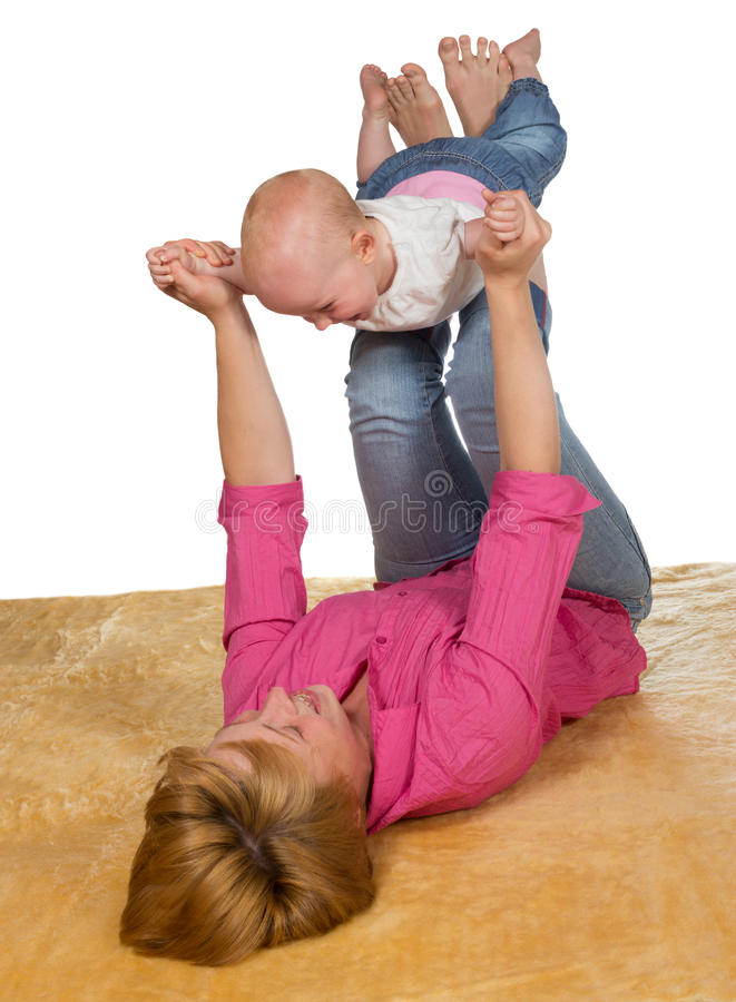 Young mother playing with her baby stock image