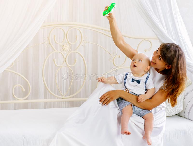 Young mother playing with her little baby royalty free stock photo