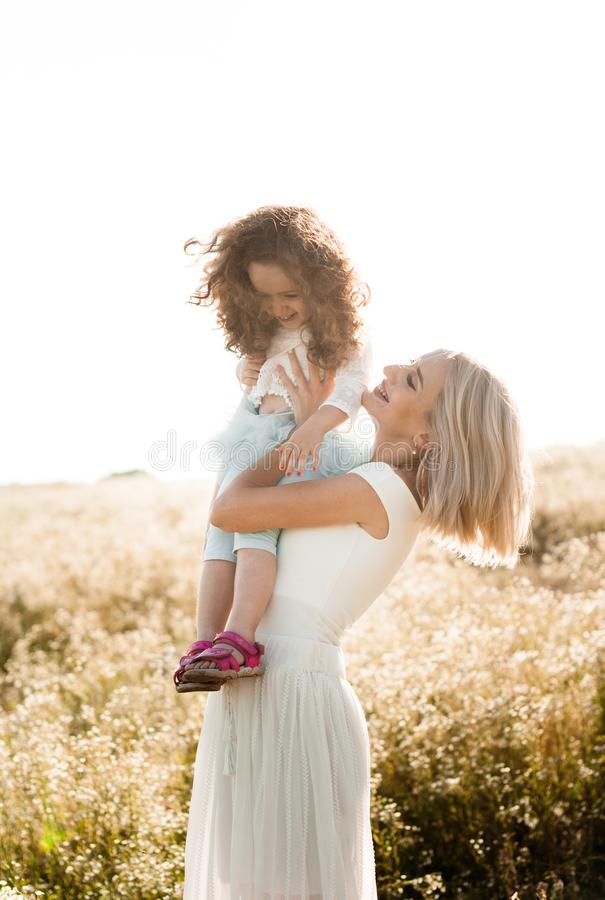 Young mother plays with her little daughter stock photography