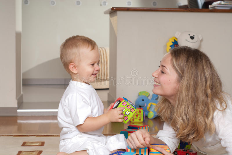 Young Mother Plays With Her Son Stock Photography