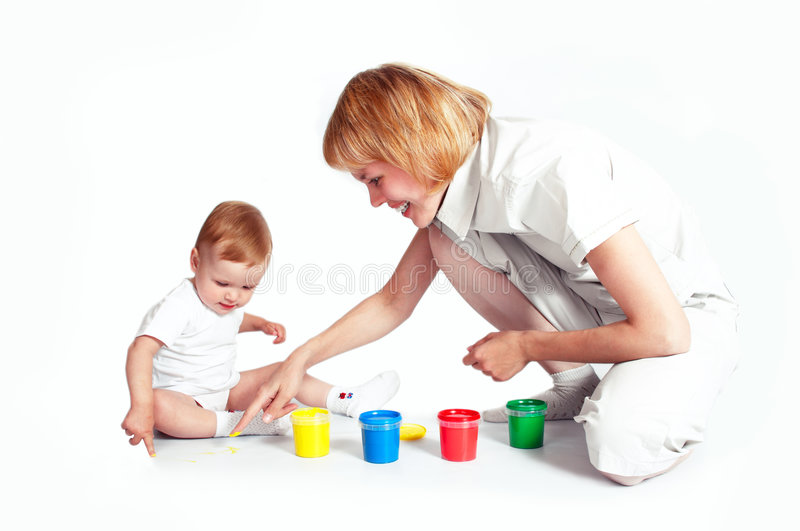 Young mother with pretty baby paint royalty free stock photography