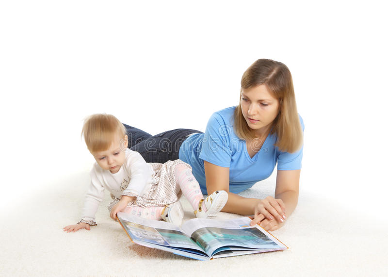 Download Young Mother Reading Book With Her Little Daughter Stock Photo - Image: 26456328