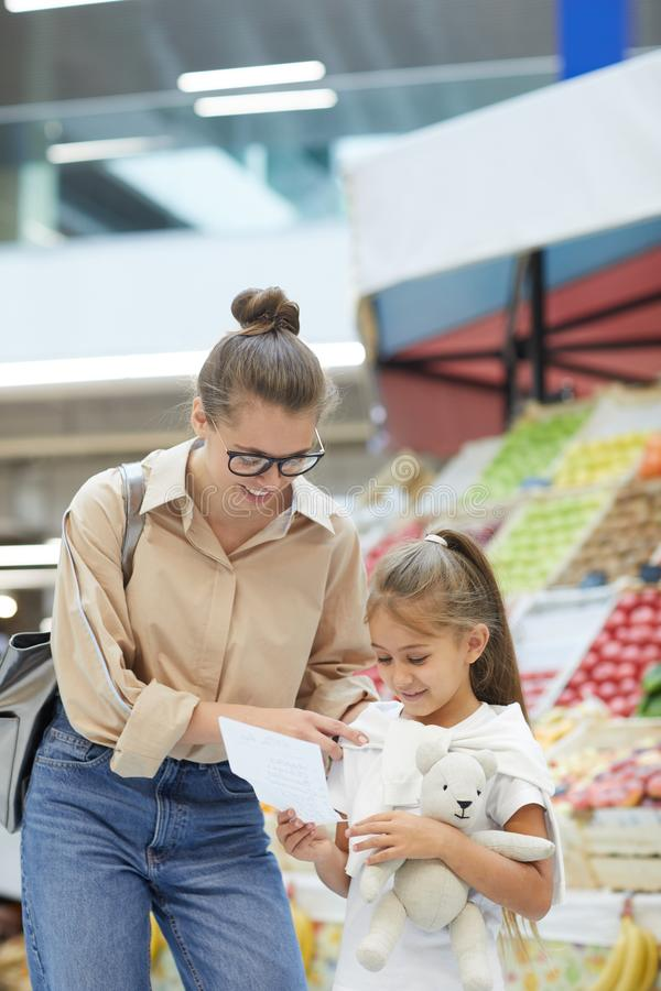 Young Mother Shopping in Farmers Market stock photos