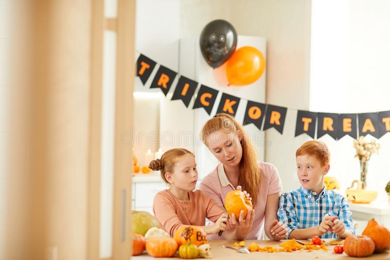 Mother with children preparing for Halloween royalty free stock photography