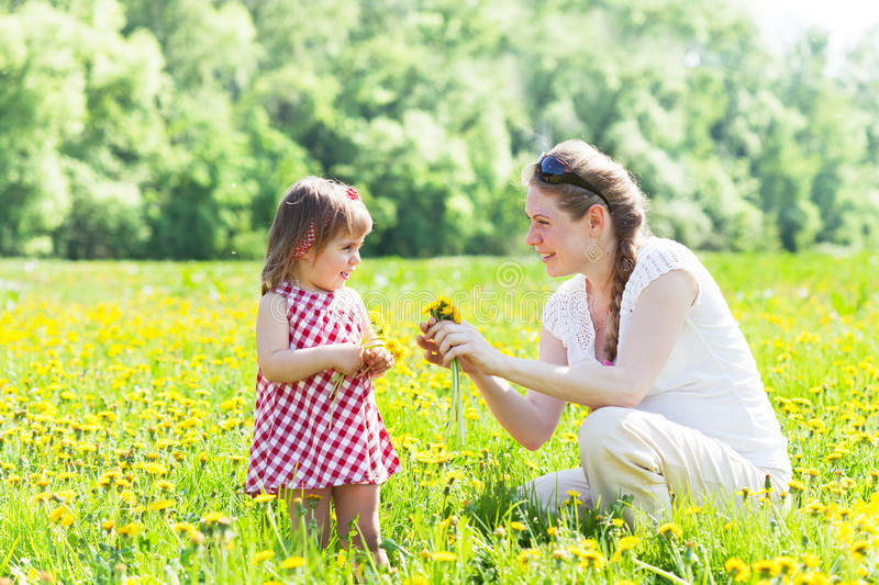 Young mother with the small daughter royalty free stock photos