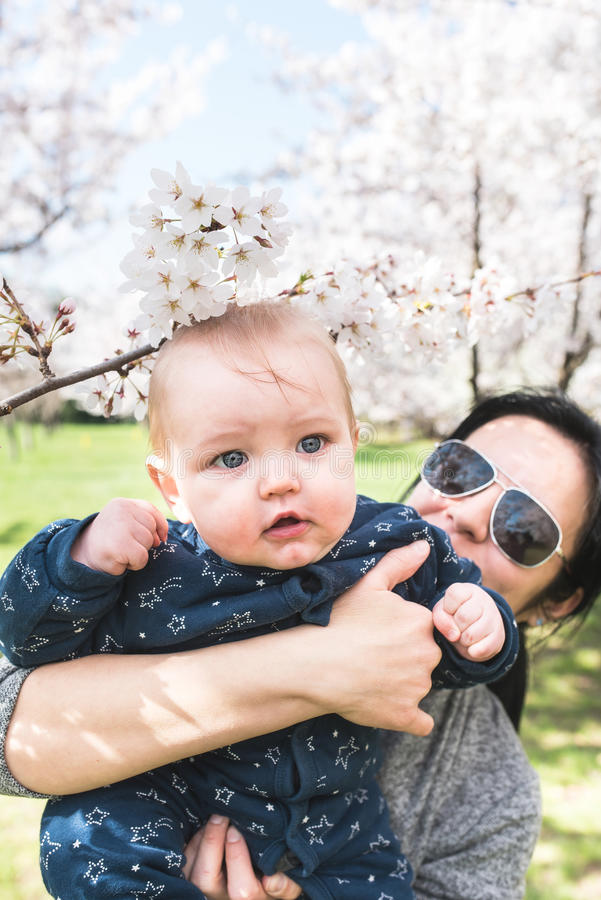 Young mother and son in the park royalty free stock photo