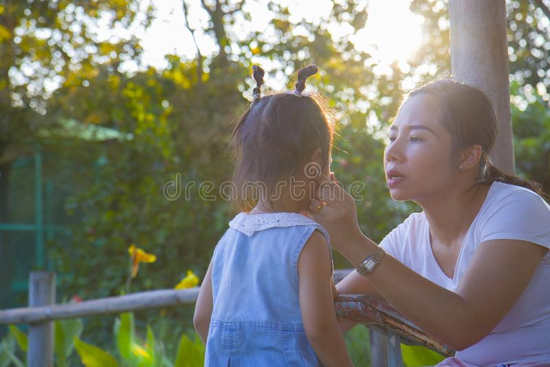 Young mother soothing a crying little daughter, Asian mother trying to comfort and calm down her crying child. High resolution image gallery royalty free stock photo