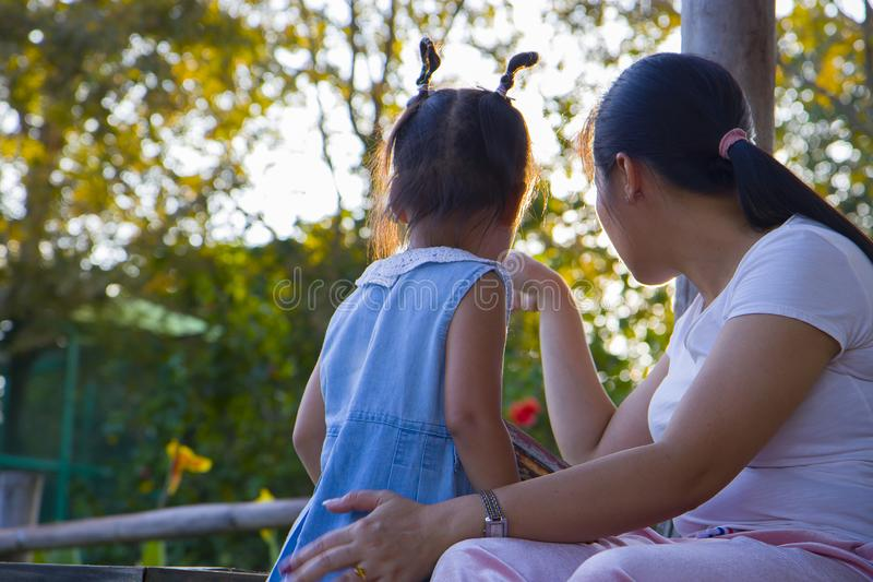 Young mother soothing a crying little daughter, Asian mother trying to comfort and calm down her crying child. High resolution image gallery royalty free stock photos