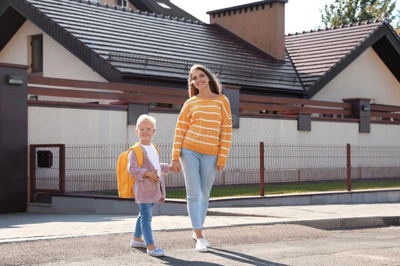 Young mother taking her little child to school stock photos
