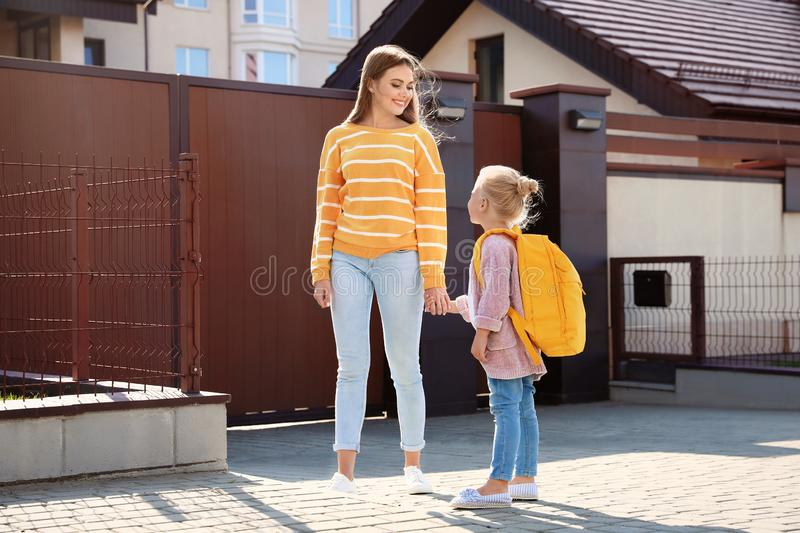 Young mother taking her little child to school royalty free stock image