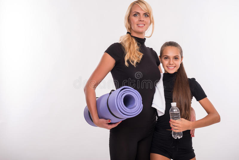Young mother and teenager daughter stock photos