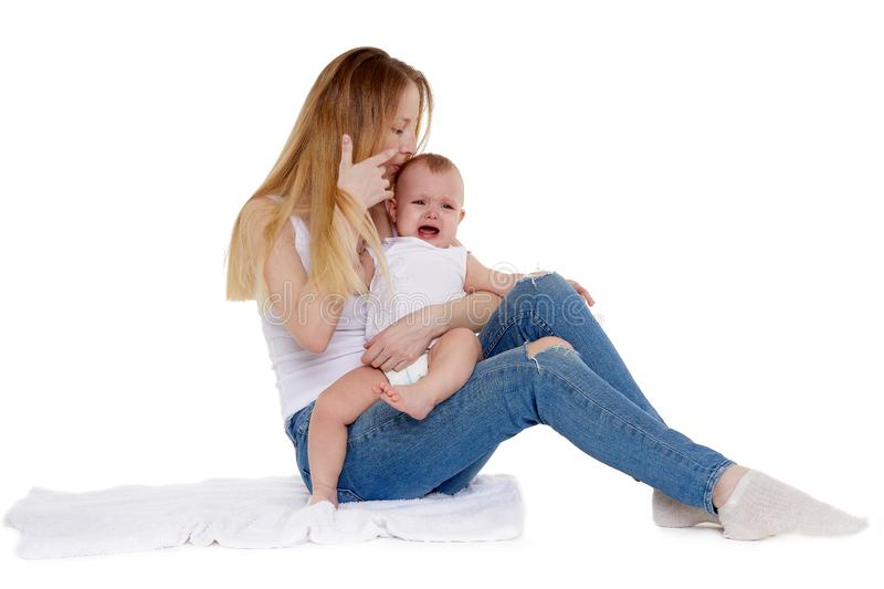 Mother with small crying baby royalty free stock photos
