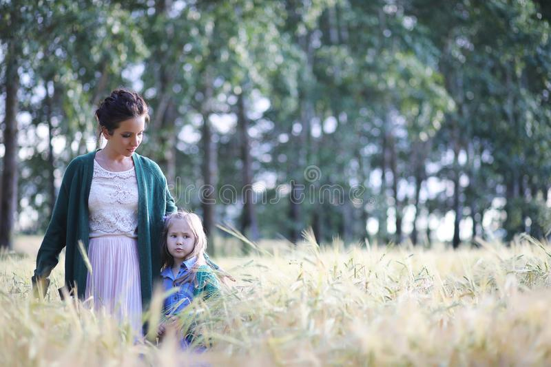 A young mother walk in wheat fields stock image