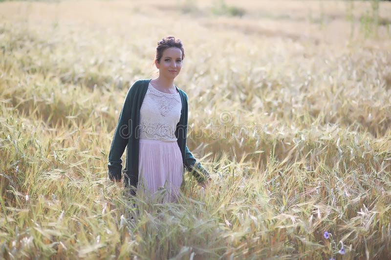 A young mother walk in wheat fields royalty free stock photography