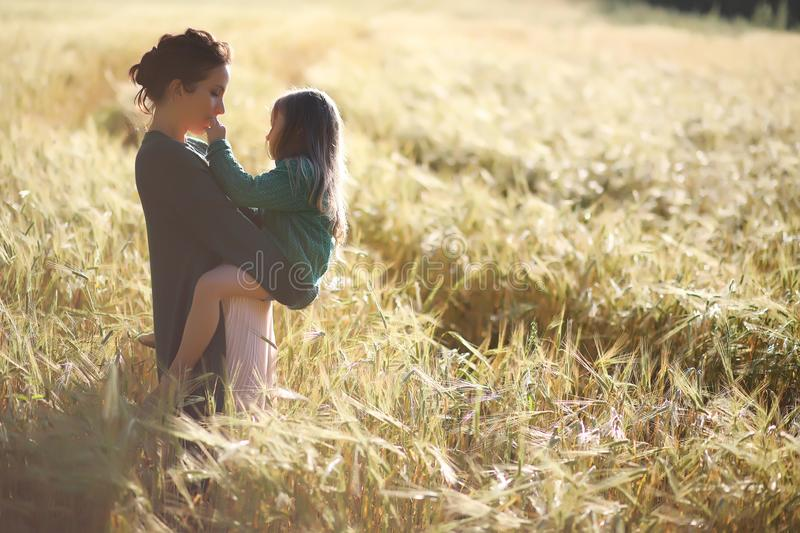 A young mother walk in wheat fields stock photography