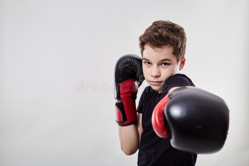 Young muay thai fighter. Young boy muay thai fighter in various postures stock photos