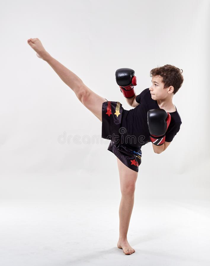 Young muay thai fighter. Young boy muay thai fighter in various postures royalty free stock images