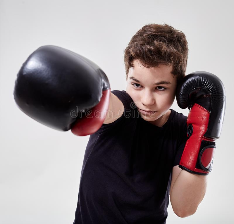 Young muay thai fighter. Young boy muay thai fighter in various postures royalty free stock photos