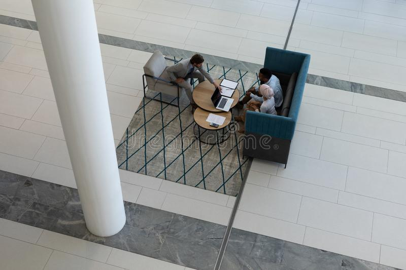 Young multi-ethnic business people working in the lobby stock images