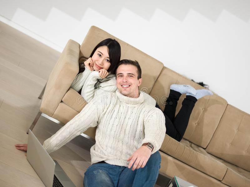 Young multi ethnic couple having wonderful time stock photo