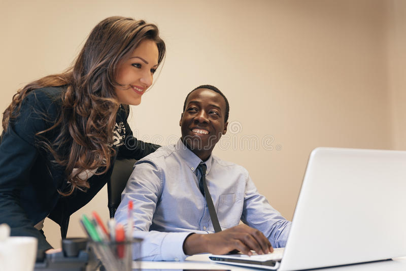 Young Multi-Ethnic Couple Working. royalty free stock photos