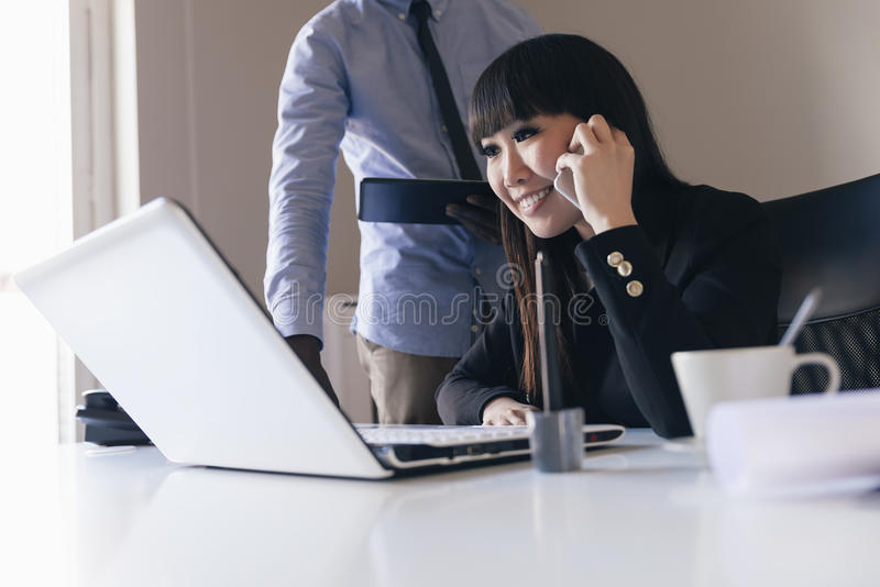 Young Multi-Ethnic Couple Working. stock image