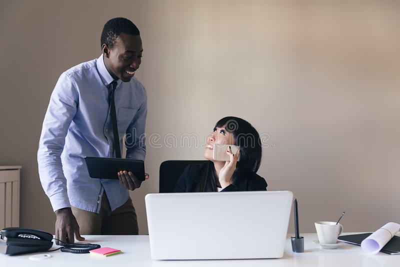Young Multi-Ethnic Couple Working. stock photography