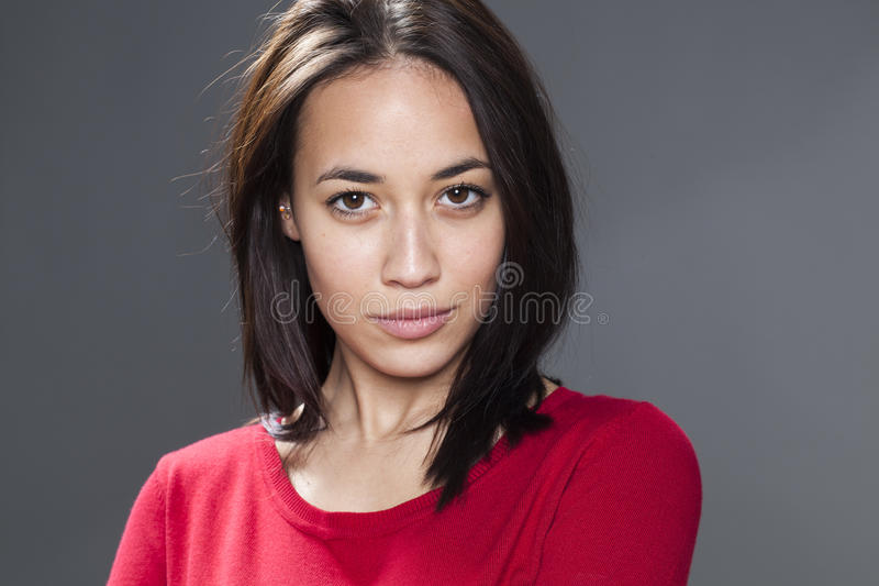 Young multi-ethnic woman looking at camera with look stock photo