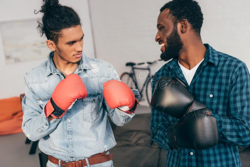 young multicultural male friends boxing royalty free stock images