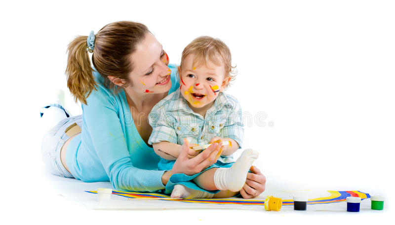 Young mum draws with the son paints stock photo