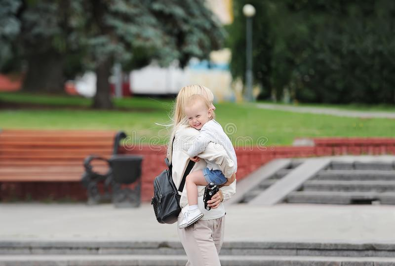 Young mum walks with the baby daughter in city park stock image