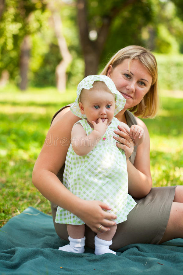 Young mum walks with the child stock photos