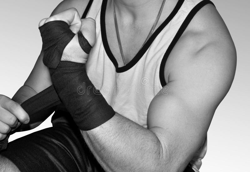 Download Young Muscular Fighter Wrapping Wrists For MMA Stock Image - Image: 17095231
