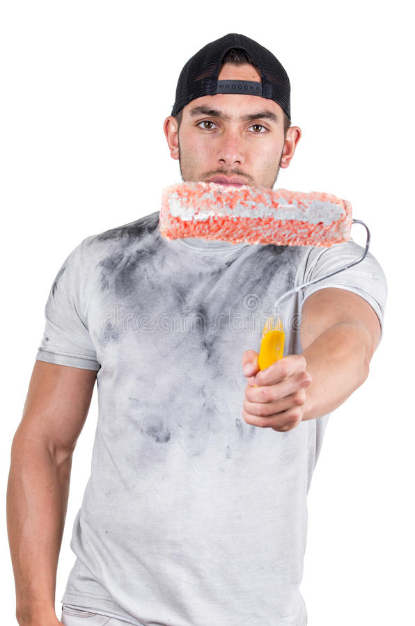 Young muscular latin construction painter. Young muscular latin construction worker painter holding paint roller isolated on white royalty free stock photos