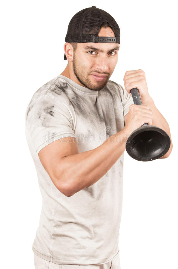 Young muscular latin janitor. Happy young muscular latin janitor holding plunger isolated on white royalty free stock photos
