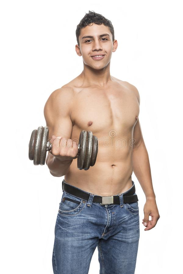 Young muscular man in gym royalty free stock images