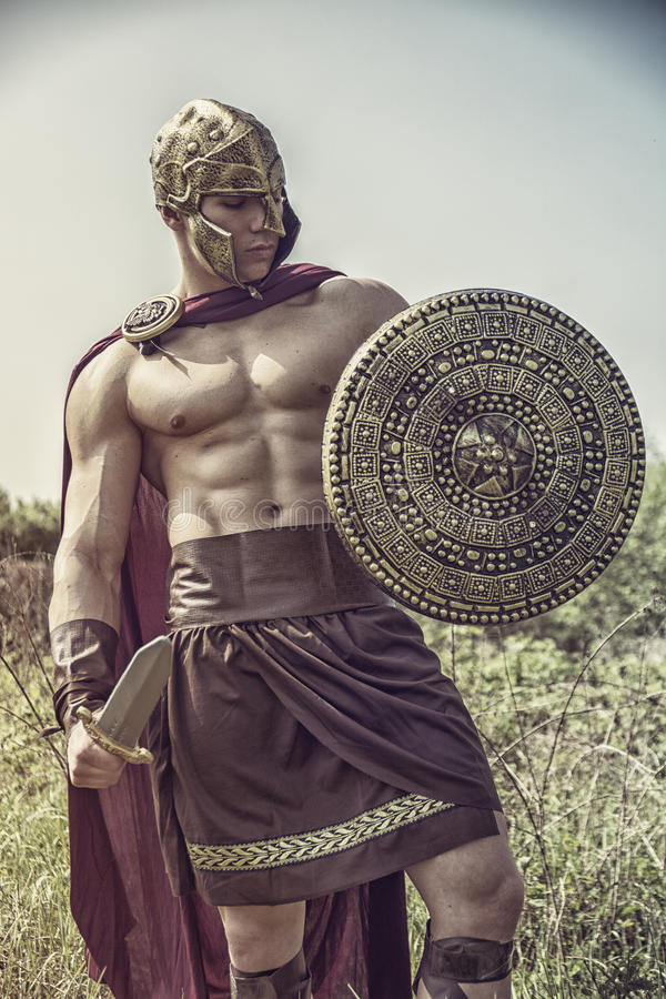 Download Young Muscular Man Posing In Gladiator Costume Stock Photo - Image of male nature : real gladiator costume  - Germanpascual.Com