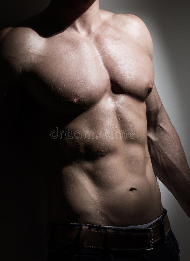 Young muscular man torso royalty free stock photo