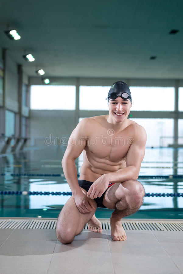 Young muscular swimmer royalty free stock image