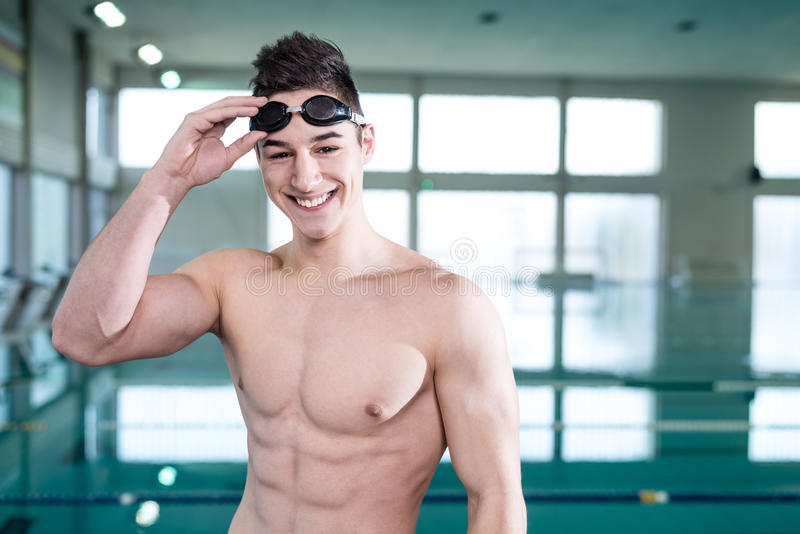 Young muscular swimmer with protective glasses royalty free stock photos
