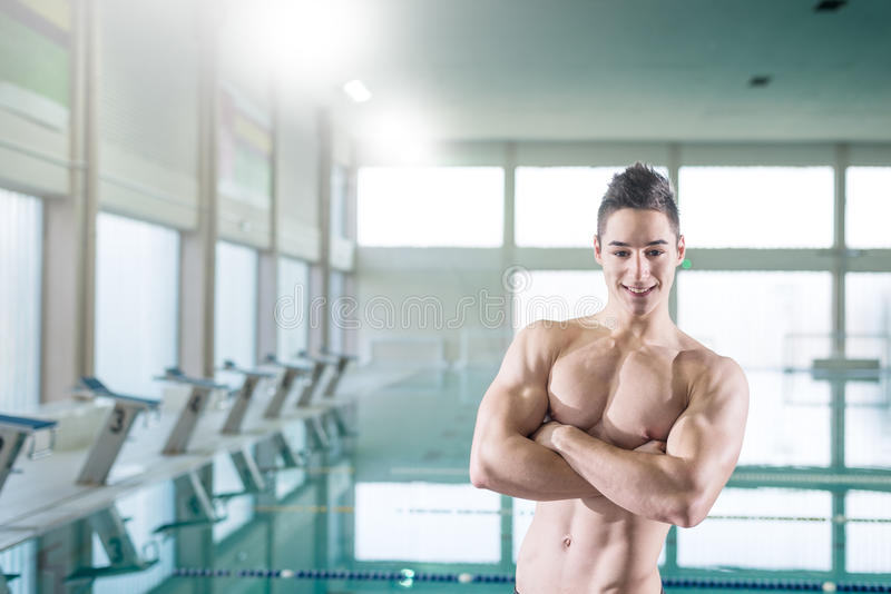 Young muscular swimmer stock images