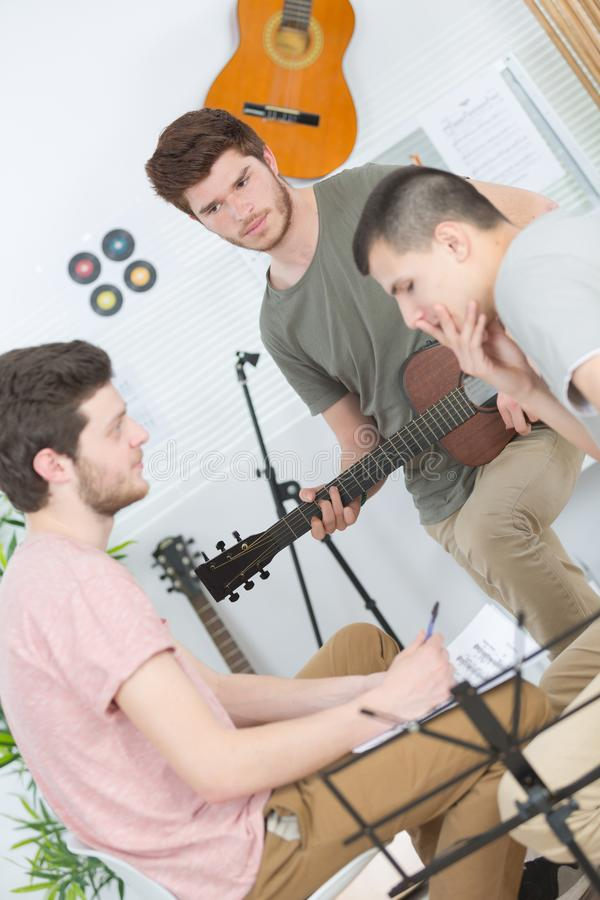 Young music composers deep in thought. Compose stock photos