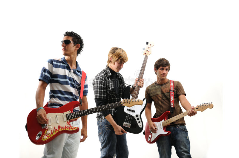 Young musical band. Trendy group of teenagers with musical instruments - isolated royalty free stock image