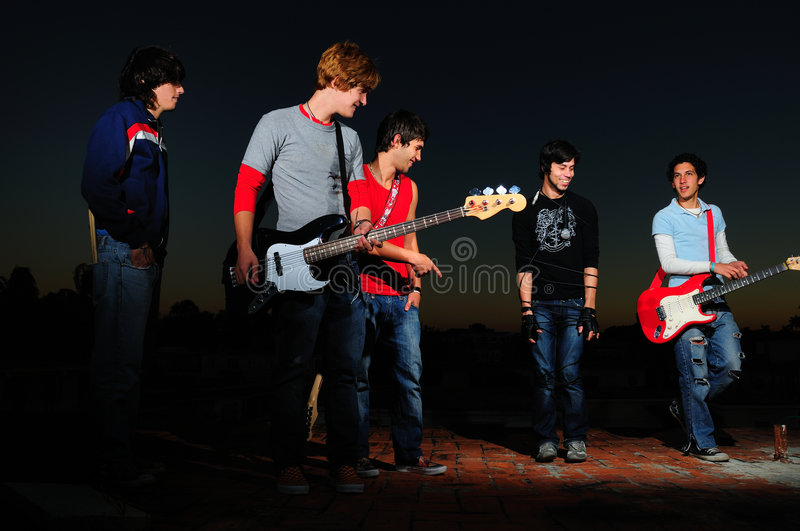 Young musican band. Portrait of a group of young musicians with instruments royalty free stock photography