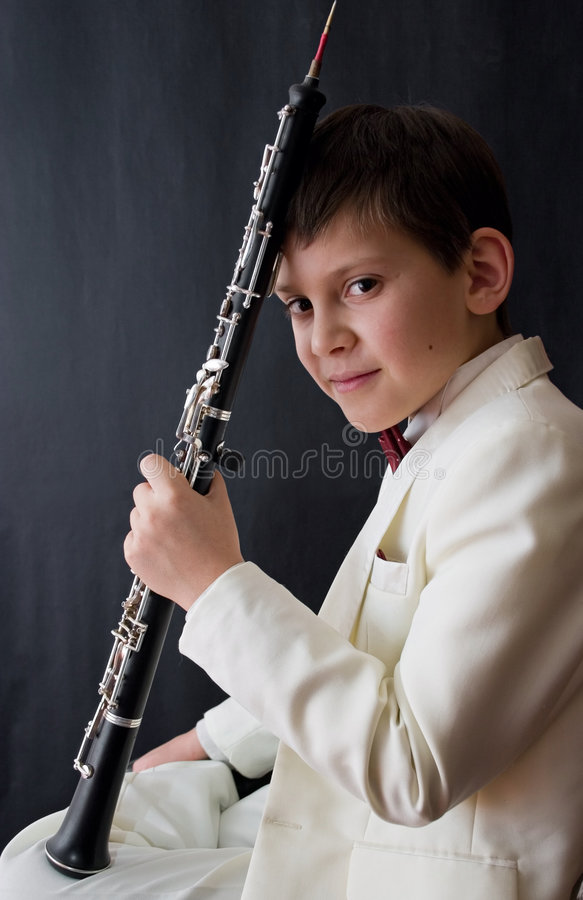 Young musician. Portrait of the young musician on a dark background royalty free stock photos