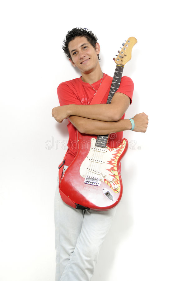 Young musician with electric gitar. Young musician holding his electric guitar - isolated stock image